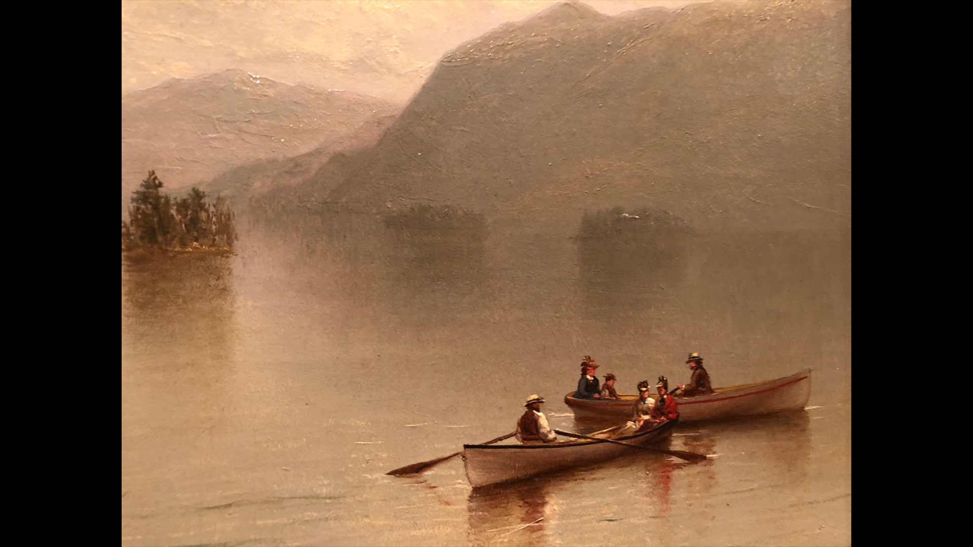A cropped view of a painting depicting two boats out on the water in the Adirondacks.